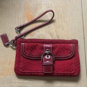Buckle and Red Coach Wristlet